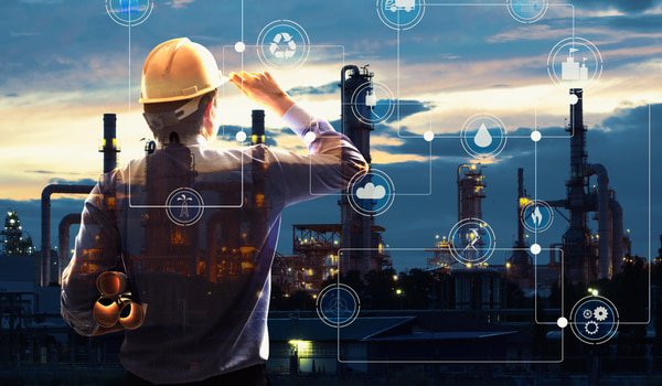 Double exposure of Engineer with oil refinery industry plant background