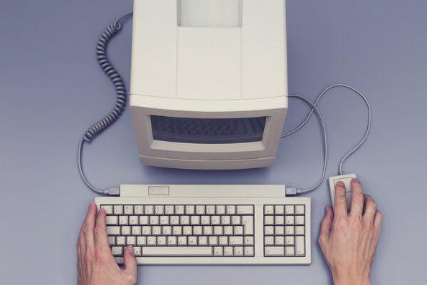 A hand using a Retro computer